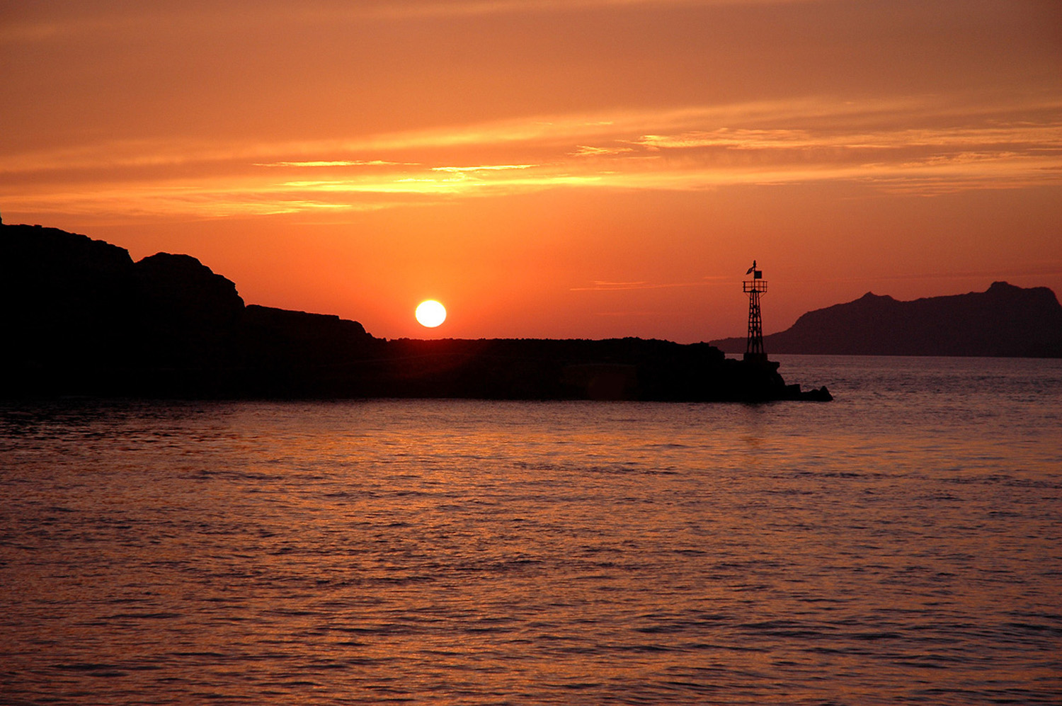 Website - A26 - Santorini-Setting Sun and Lighthouse